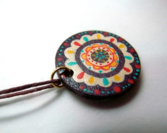 reversible handpainted pendant in eggplant and ivory