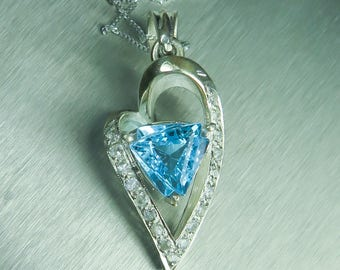 3.95cts Natural sky blue topaz 9.36x9.45mm, trillion cut 925 sterling silver heart pendant 38.40x16.47mm