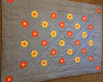 Chambray appliqued crib or lap quilt