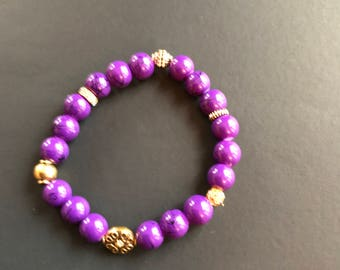 """Purple lovers:  8 inch Purple Glass beads with metallic accents 8"""" stretch bracelet"""