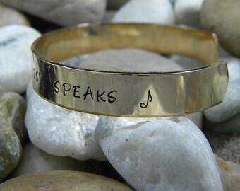 Where Words Fail Music Speaks hand stamped bracelet - Hammered Brass