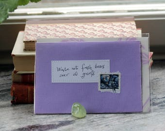 Waste not fresh tears over old griefs Pale lilac card with handwritten quote and Swedish pebble heart postal stamp