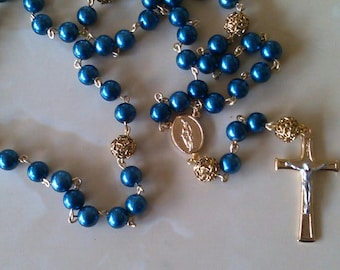 Blue glass pearl rosary made with golden accents(.)
