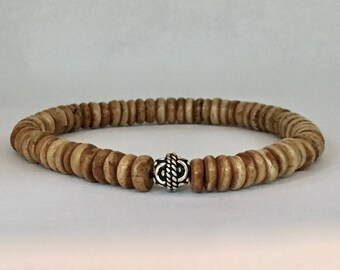Men's medium brown ox bone bracelet with a bali sterling silver bead