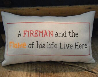 A Fireman and the Flame of his Life Lives here -  pillow