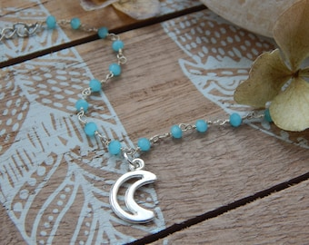 Bracelet with beaded chain, and moon pendant.