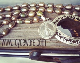 Handmade sterling silver smoky quartz and  hand knotted freshwater silver taupe colored pearls.