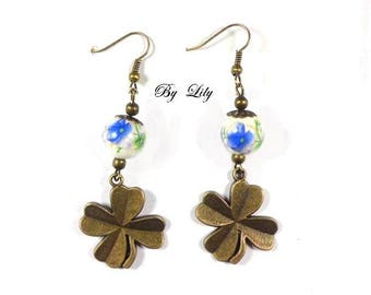 "Earrings ""bronze 4-leaf clovers and blue flowery beads""."