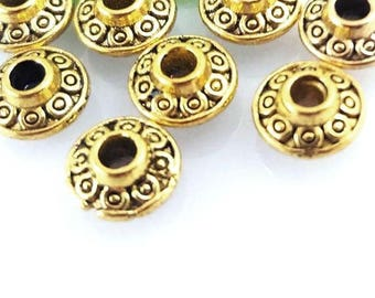 20 pieces UFO spacer beads, dark gold metal, decorated with engraved dots, 0.24 inches diameter