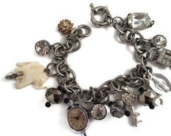 Charm bracelet with all recycled charms, lots of rhinestones