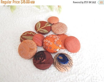 CLEARANCE - 11 orange rust mix fabric covered buttons, mixed sizes