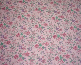 Vintage fabric flowers on pink background