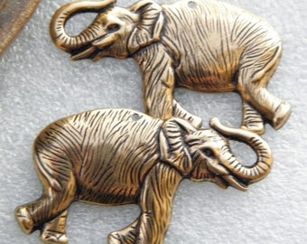 Set of 2 prints elephants trunk in air pendants lucky bronze old gold vintage