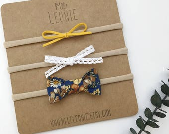 Trio earrings mixed on headband - baby girl and child - mustard yellow suede, lace white cotton mini, mustard flowers on Navy Blue