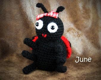 June Ladybug - crochet, red and black stuffed ladybug toy with ribbon