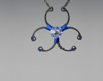 Blue Swarovski Crystal Biohazard Pendant, Swarovski Necklace, Light Sapphire Swarovski Crystal, Wire Wrapped Pendant, Biohazard Blue v6