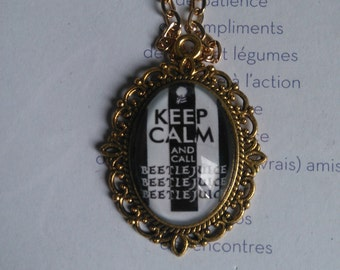 """chain and medallion of color gold with """"keep calm and beetlejuice"""""""