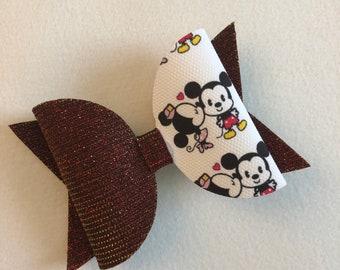 Minnie kissing Mickey Bow clip