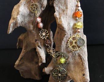 steampunk necklace with gears and glass jar vintage