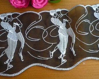 """White embroidery on """"skaters"""" sewing pattern black tulle"""