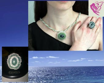 author's work - flower ring and a pendant on a a plait of