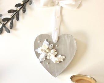 Coeur à L'ange et son bouquet de fleurs