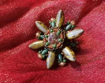 Flower brooch in earth color