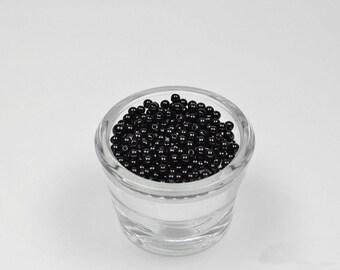 200 black plastic round beads 4 mm in diameter