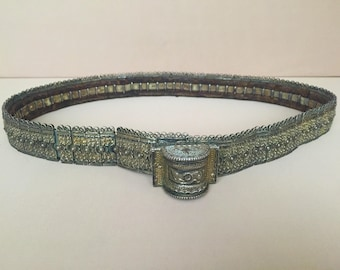 Caucasian-antique silver belt with old leather.
