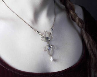 FLEUR DE LIS necklace made with old timepieces.