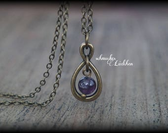 Antique Bronze Infinity gemstone necklace with Amethyst