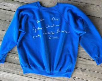 Large hand embroidered names sweatshirt