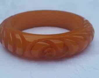 Vintage Bakelite carved bangle - orange