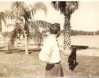 "Vintage Snapshot ""Loud Noise"" Man & Dog Look Out Over Harbor Palm Trees Black Dog Found Vernacular Photo"