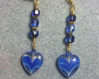 Bright blue Czech glass heart bead dangle earrings adorned with bright blue Czech glass beads.