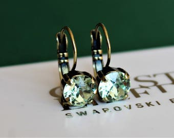 Antique Brass Plated Leverback Earrings made with Chrysolite Green Swarovski Crystal Elements. Earrings by Lady C