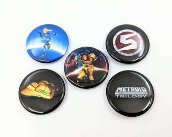 "5 Pack 1.25"" Metroid Samus Buttons or Magnets - Samus, Zero Suit Samus, Prime Logo, Trilogy Logo, and Samus's Ship"