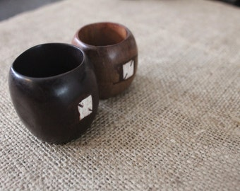 Pair of Mahogany African Napkin rings with Embeded Acrylic symbol
