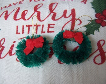 two tiny wreath decorations