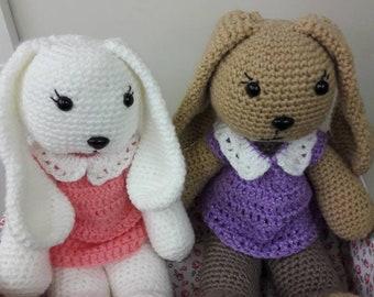 Amigurumi Bunny with crocheted dress and pom pom tail.