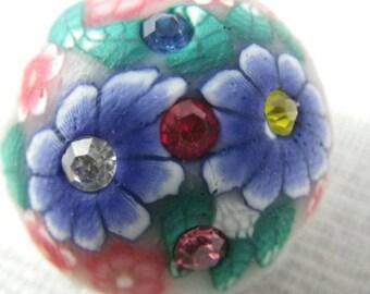 Bouton pression fleurs bleues et roses