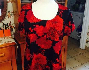 Beautiful red roses on black background, medium weight knit with a rich look.