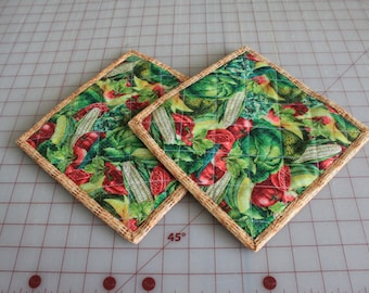 A quilted potholder vegetables. reversible; insulated