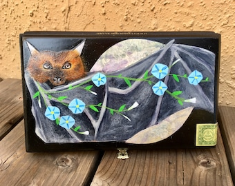 Magical Bat painting in acrylic on a cigar box