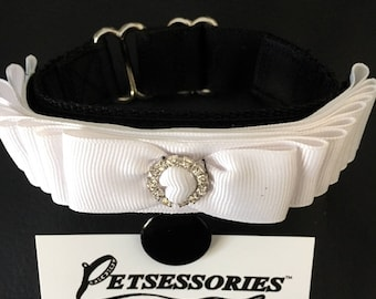 Petsessories® Interchangeable Armband Number Holder is black, includes 1 Elegant Ribbon Cover- choice of color.  Black round clip included