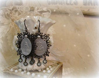 devotee one of a kind vintage assemblage earrings very vintage holy medals riveted to blackened reproduction filigrees tiny bezel set drops