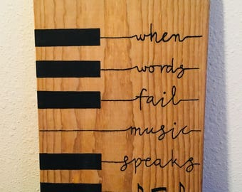 When words fail music speaks on weathered pine