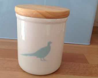 Ceramic storage jar with wooden lid and pheasant image