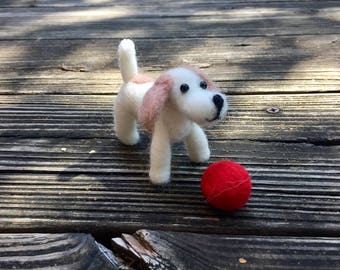 Light tan felted spotted dog w/red ball