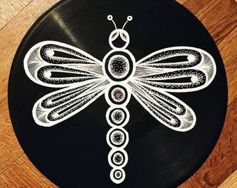 Art on vinyl - Abstract line drawing of a dragonfly on a vinyl record